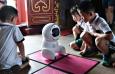 Китай: Роботи стават възпитатели в детските градини